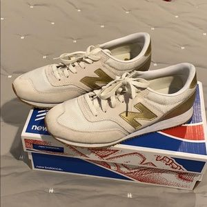 New balance white suede and gold tennis.